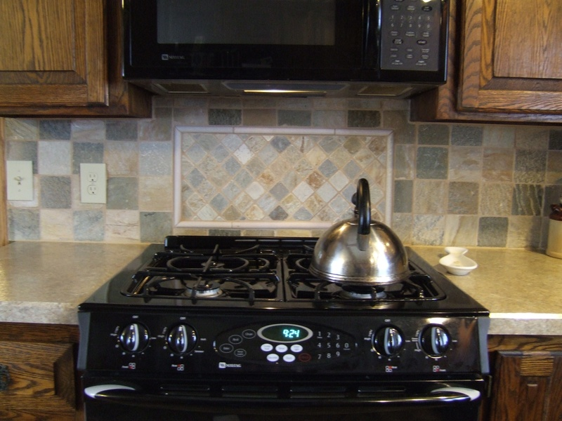 slate tile backsplash with diagonal inset